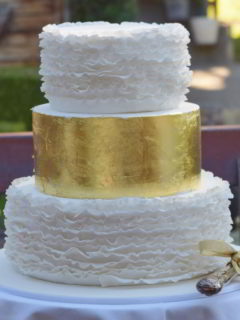 Gold leaf and ruffles wedding cake